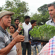TAU Prof. Ram Fishman and agricultural expert Omar Zaidan explain seedling use to farmers in India. Credit: the Nitzan Lab