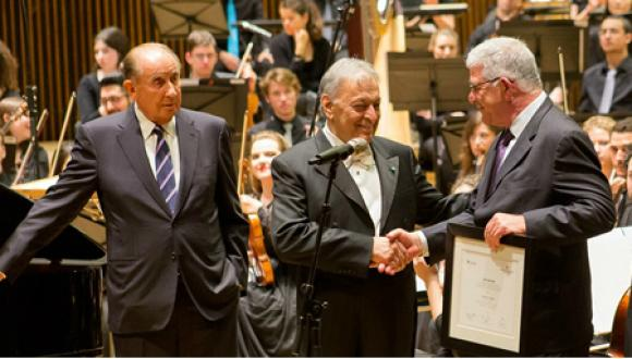 Maestro Zubin Mehta congratulates Head of the Buchmann-Mehta School of Music Prof. Zeev Dorman (right) as TAU benefactor Josef Buchmann looks on