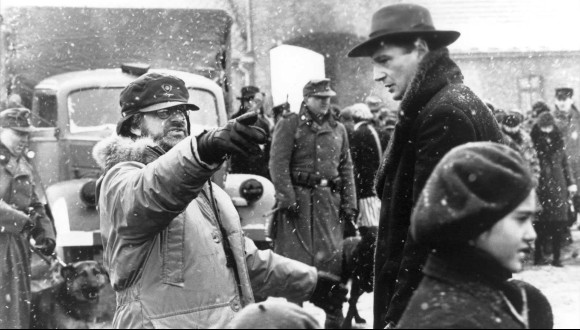 Director Steven Spielberg with cast on the film set of Schindler's List (1993).